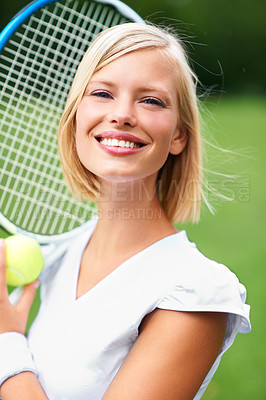Buy stock photo Portrait of a young female tennis player holding a ball and racquet