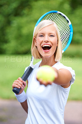 Buy stock photo Portrait of a young female tennis player holding her racquet and offering you the ball