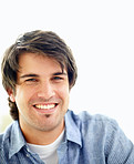 Handsome young man smiling against white