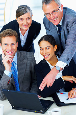 Buy stock photo Portrait of a business team - Business team at a meeting in a light and modern office.