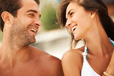 Buy stock photo Two attractive adults gazing into each other's eyes with laughter and love