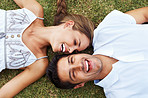 Couple relaxing together on grass