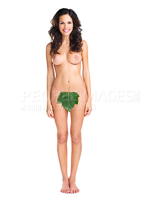 Buy stock photo Studio shot of a cheerful young nude woman partially covered by a fig leaf while standing against a white background
