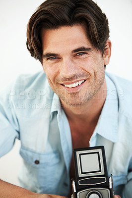 Buy stock photo A sexy photographer holding a classic Rolleiflex camera