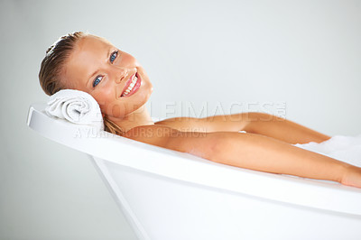 Buy stock photo Portrait of a happy and stunning young woman relaxed in her bath