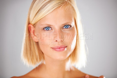 Buy stock photo Closeup of a stunning young woman looking at you with her beautiful eyes