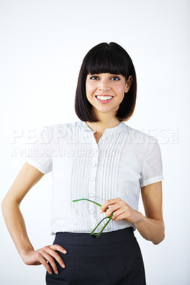 Buy stock photo Portrait of a confident businesswoman holding glasses and smiling at you