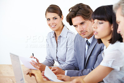 Buy stock photo Portrait of a beautiful young executive at a meeting with her business team