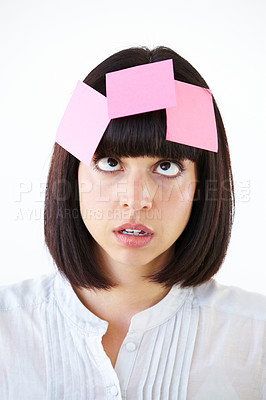 Buy stock photo Conceptual image of an overworked businesswoman with notes stuck to her head.