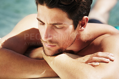 Buy stock photo High angle view of a handsome male relaxing in a pool on a sunny day - Cropped