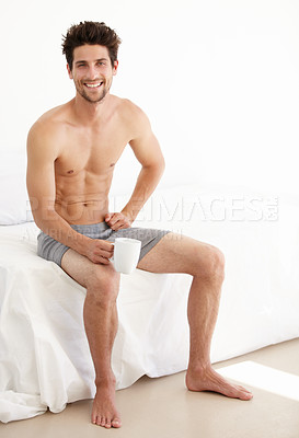Buy stock photo Full-length portrait of a fit young man sitting in his underwear holding a coffee mug - Copyspace