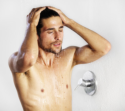 Buy stock photo Young sexy male relaxing as he runs his hands over his hair while showering
