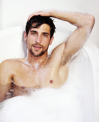 Buy stock photo Portrait of a sexy man relaxing in a bath tub full of bubble bath