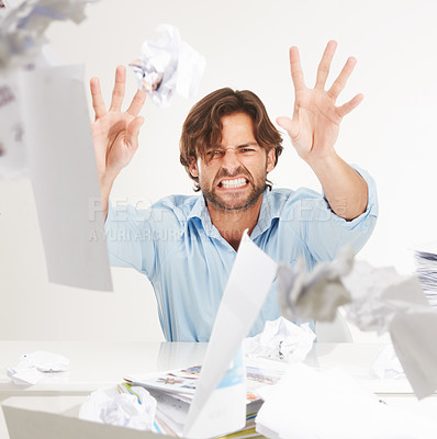 Buy stock photo Frustrated male throwing crumpled up papers at the camera in anger