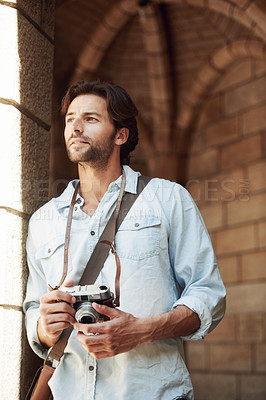 Buy stock photo Shot of a handsome young tourist checking out the sights