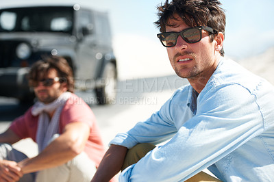 Buy stock photo Shot of a young man on a roadtrip