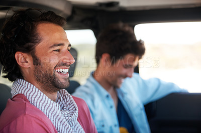 Buy stock photo Two friends happy and laughing together while on a drive