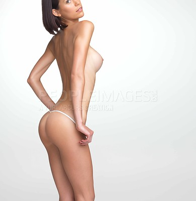 Buy stock photo Perfectly toned sexy woman posing nearly naked against a white background - copyspace