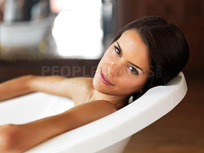 Buy stock photo Gorgeous young woman relaxing in a bath tub