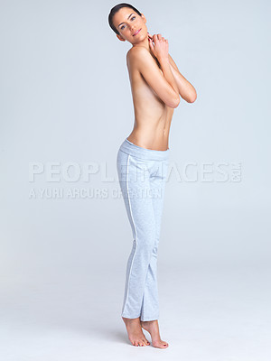 Buy stock photo Healthy young woman standing topless while wearing yoga pants