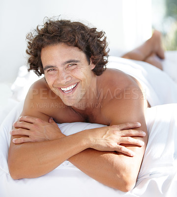 Buy stock photo Portrait of a handsome young man relaxing at home