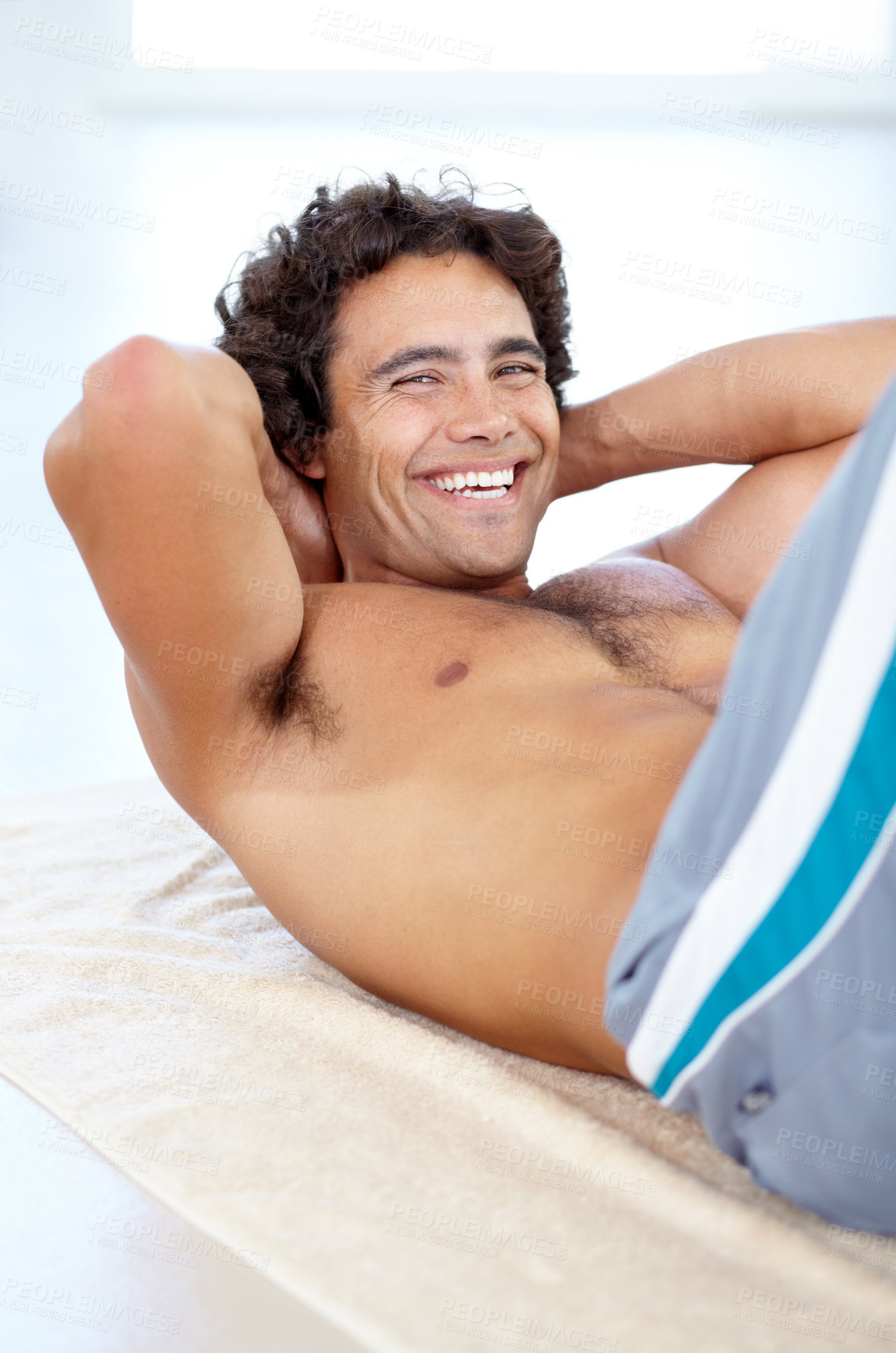 Buy stock photo A sexy young man doing situps on the floor