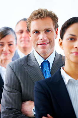 Buy stock photo Business team and a leader - Mature business man with his colleageus in the background