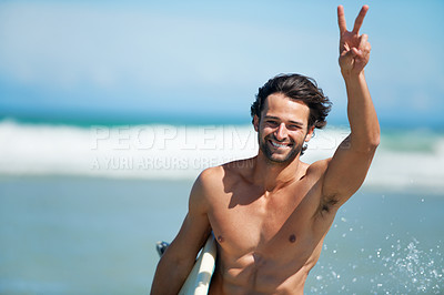 Buy stock photo A young man waving to his friend in the distance