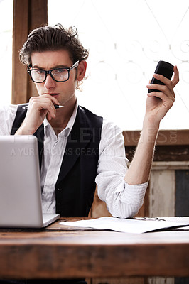 Buy stock photo A young man wondering how best to record the information