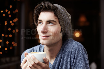 Buy stock photo A young male with coffee gazing upwards