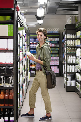 Buy stock photo A young man at the store buying groceries