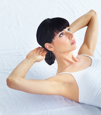 Buy stock photo Young fit woman doing sit-ups and looking away
