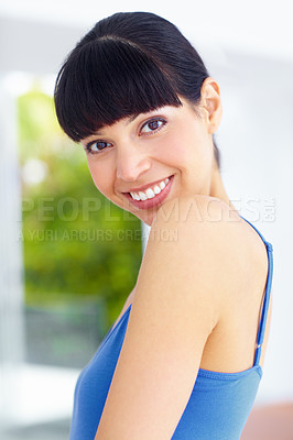 Buy stock photo Shot of a young woman wearing exercise clothing giving you a broad smile