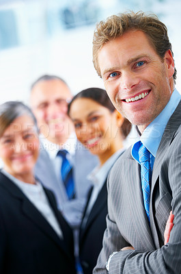 Buy stock photo Business team and a leader - Mature business man with his colleagues in the background
