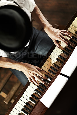 Buy stock photo High-angle view of a young musician playing the piano