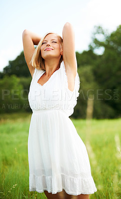 Buy stock photo Beautiful young woman standing outdoors enjoying the country air