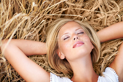 Buy stock photo Beautiful young woman relaxing in a field of wheat
