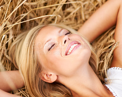 Buy stock photo Happy young woman lying in a field of wheat