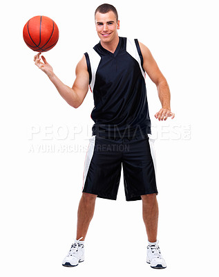 Buy stock photo Happy young boy spinning ball on fingers smiling against isolated white background