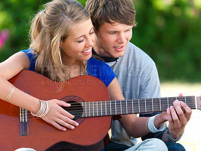 Buy stock photo Young couple with a guitar