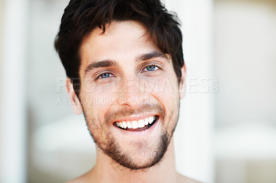 Buy stock photo Attractive young male smiling and looking at the camera