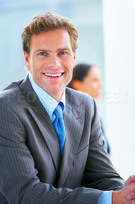 Buy stock photo Mature businessman, relaxed and smiling with his colleagues in the background