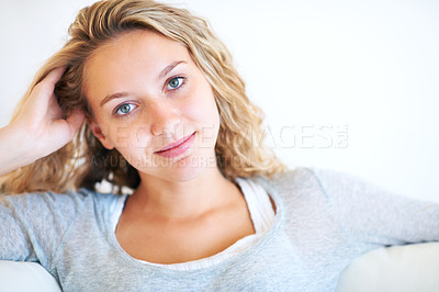 Buy stock photo Portrait of a pretty young woman relaxing at home - Copyspace