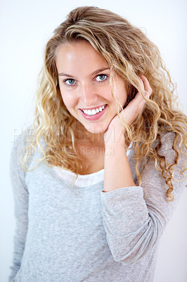 Buy stock photo Portrait of a pretty young blonde smiling at you sweetly