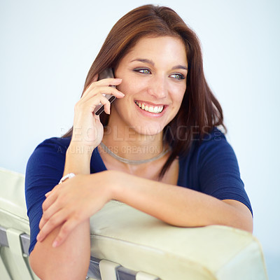 Buy stock photo A beautiful young woman speaking on her mobile phone