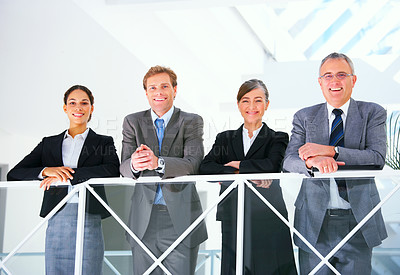 Buy stock photo Portrait of a business team - Business team at a meeting in a light and modern office setting.
