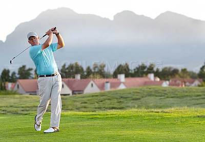 Buy stock photo A male golfer admiring the shot he has just played