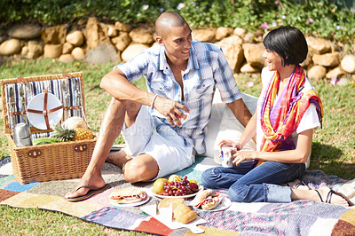 Buy stock photo Shot of a happy young couple on a picnic