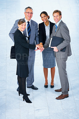 Buy stock photo Handshake and teamwork. Two businessmen shaking hands in a light and modern office setting.