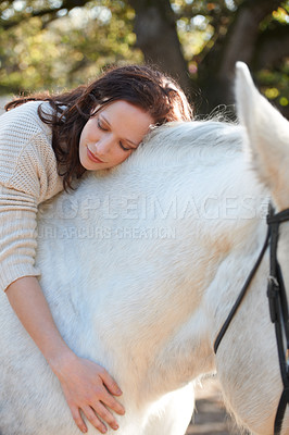 Buy stock photo An attractive woman sitting on her horse with her eyes closed
